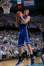 CHAPEL HILL, NC - MARCH 05: Miles Plumlee #21 of the Duke Blue Devils grabs a defensive rebound while playing the North Carolina Tar Heels on March 05, 2011 at the Dean E. Smith Center in Chapel Hill, North Carolina. North Carolina won 67-81. (Photo by Peyton Williams/UNC/Getty Images) *** Local Caption *** Miles Plumlee