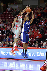 07 January 2015:   Gary Ricks, Jr. offers a long shot with a block attempt by Tony Wills during an NCAA MVC (Missouri Valley Conference) men's basketball game between the Drake Bulldogs and the Illinois State Redbirds at Redbird Arena in Normal Illinois.  Illinois State comes out victorious 81-45.