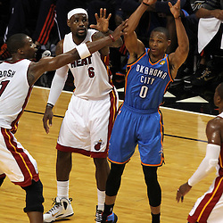 Jun 19, 2012; Miami, FL, USA; Oklahoma City Thunder point guard Russell Westbrook (0) passes against Miami Heat small forward LeBron James (6) during the first quarter in game four in the 2012 NBA Finals at the American Airlines Arena. Mandatory Credit: Derick E. Hingle-US PRESSWIRE