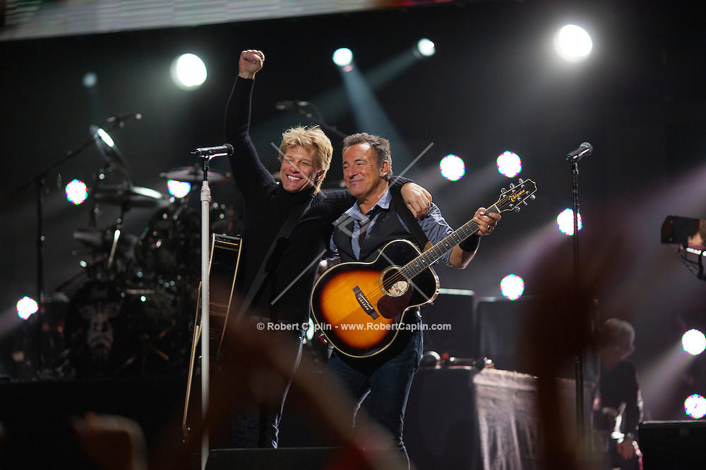 Jon Bon Jovi and Bruce Springsteen at the 12-12-12 fundraising concert to aid the victims of Hurricane Sandy, will take place on December 12, 2012 at Madison Square Garden. The concert featured The Rolling Stones, Bon Jovi, Eric Clapton, Dave Grohl, Billy Joel, Alicia Keys, Chris Martin, Bruce Springsteen & the E Street Band, Eddie Vedder, Roger Waters, Kanye West, The Who, and Paul McCartney. All the proceeds went go to the Robin Hood Relief Fund. Robin Hood, the largest independent poverty fighting organization in the New York area, will insure that every cent raised will go to non-profit groups that are helping the tens of thousands.of people throughout the tri-state area who have been affected by Hurricane Sandy...Photo © Robert Caplin..