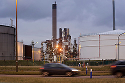Automobiles pass by the Petroplus Holdings AG oil refinery, at the Port of Antwerp, in Antwerp, Belgium, Friday, Jan. 6, 2012. (Photo © Jock Fistick)