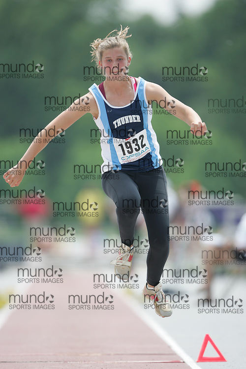 (London, Ontario}---04 June 2010) Jackie Bray of St. Theresa - Midland competing in the senior girls triple jump at the 2010 OFSAA Ontario High School Track and Field Championships. Photograph copyright Sean Burges / Mundo Sport Images, 2010.