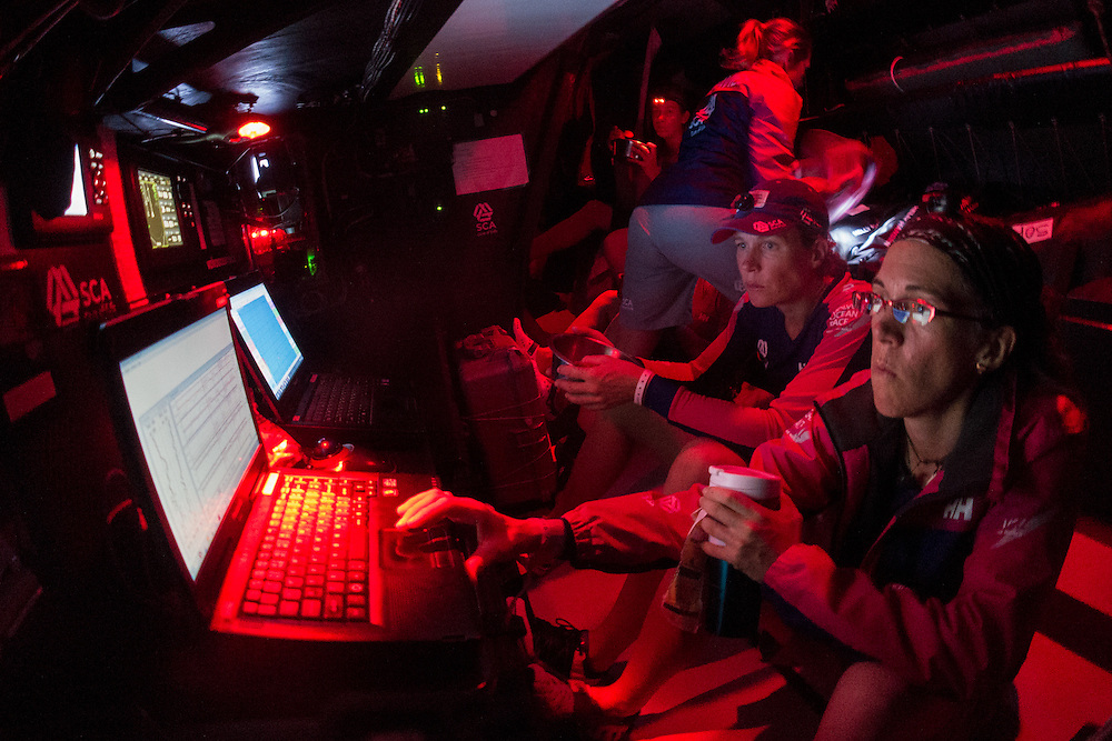 April 19, 2015. Leg 6 to Newport onboard Team SCA. Day 0. Libby Greenhalgh and Carolijn Brouwer watch the teams performance as they determine when to tack.