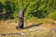 Octogenarian nun, Christina, takes a walk from the Serbian Orthodox St. John of Kronstadt monastery, near the village of Korita, Republika Srpska, Bosnia and Herzegovina.