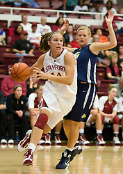 November 1, 2009; Stanford, CA, USA;  Stanford Cardinal forward Kayla Pedersen (14) dribbles along the baseline past Vanguard Lions guard Paige Halberg (23) during the second half at Maples Pavilion.  Stanford defeated Vanguard 107-49.