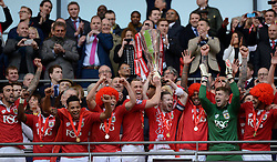 Bristol City's Aaron Wilbraham and Bristol City's Wade Elliott list the JPT trophy with fellow Bristol City players  - Photo mandatory by-line: Joe Meredith/JMP - Mobile: 07966 386802 - 22/03/2015 - SPORT - Football - London - Wembley Stadium - Bristol City v Walsall - Johnstone Paint Trophy Final