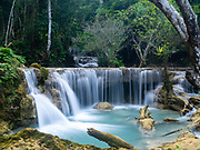 Image of Kuang Si Waterfall park, near Luang Prabang, Laos, on an overcast day.