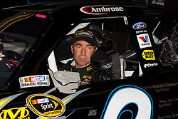 June 25, 2011; Sonoma, CA, USA;  Sprint Cup Series driver Marcos Ambrose (9) sits in his car before practice for the Toyota/Save Mart 350 at Infineon Raceway.