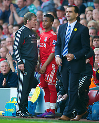 LIVERPOOL, ENGLAND - Saturday, March 24, 2012: Liverpool's manager Kenny Dalglish prepares to give Raheem Sterling his first team debut during the Premiership match against Wigan Athletic at Anfield. (Pic by David Rawcliffe/Propaganda)