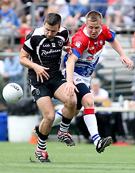 May 6, 2012; Bronx, NY; USA; New York's Conor Hogan (5) and Sligo's Alan Costello (12) chase a loose ball during their game at Gaelic Park in the Bronx, NY.