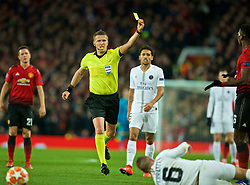 MANCHESTER, ENGLAND - Tuesday, February 12, 2019: Referee Daniele Orsato shows a yellow card to Manchester United's Paul Pogba (R) during the UEFA Champions League Round of 16 1st Leg match between Manchester United FC and Paris Saint-Germain at Old Trafford. (Pic by David Rawcliffe/Propaganda)