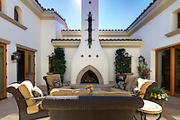 Seating furniture with fireplace in courtyard of luxury mansion