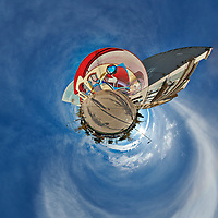 Mirror Ball Building Mural. Little Planet. Composite of 38 images taken with a Nikon D850 camera and 8-15 mm fisheye lens (ISO 64, 15 mm, f/16, 1/100 sec). Raw images processed with Capture One Pro and Auto Pano Giga.