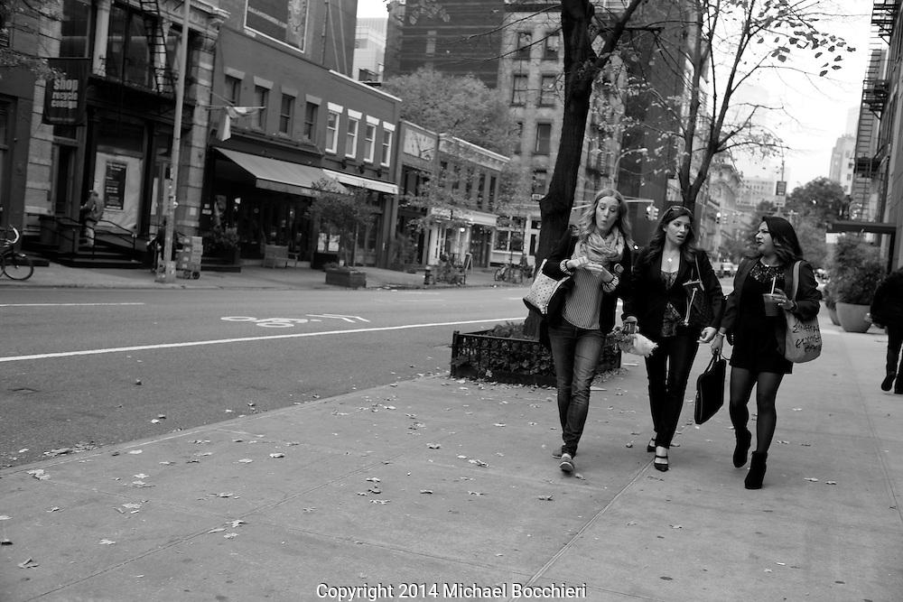 NEW YORK, NY - November 11:  Three women talk as they walk on November 11, 2014 in NEW YORK, NY.  (Photo by Michael Bocchieri/Bocchieri Archive)