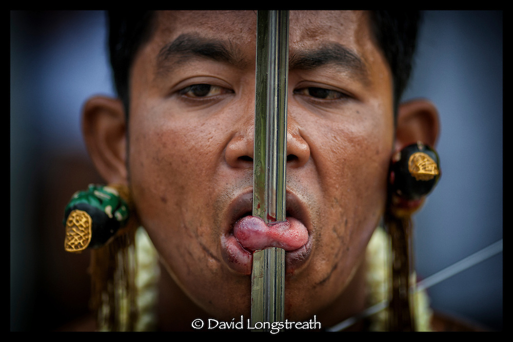 scenes from Thailand's Vegetarian Festival in Phuket, Thailand.