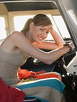 Young Woman at Wheel of Camper Van