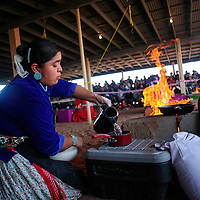 090413  Adron Gardner/Independent<br /> <br /> Miss Navajo Pageant contestant Wallita Begay pours water to mix with Blue Bird flour during the fry bread competition at the Navajo Nation Fairgrounds in Window Rock Wednesday.
