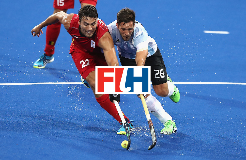 RIO DE JANEIRO, BRAZIL - AUGUST 18:  Simon Gougnard (L) of Belgium is tackled by Agustin Mazzilli during the Men's Gold Medal match between Argentina and Belgium on Day 13 of the Rio 2016 Olympic Games held at the Olympic Hockey Centre on August 18, 2016 in Rio de Janeiro, Brazil.  (Photo by David Rogers/Getty Images)