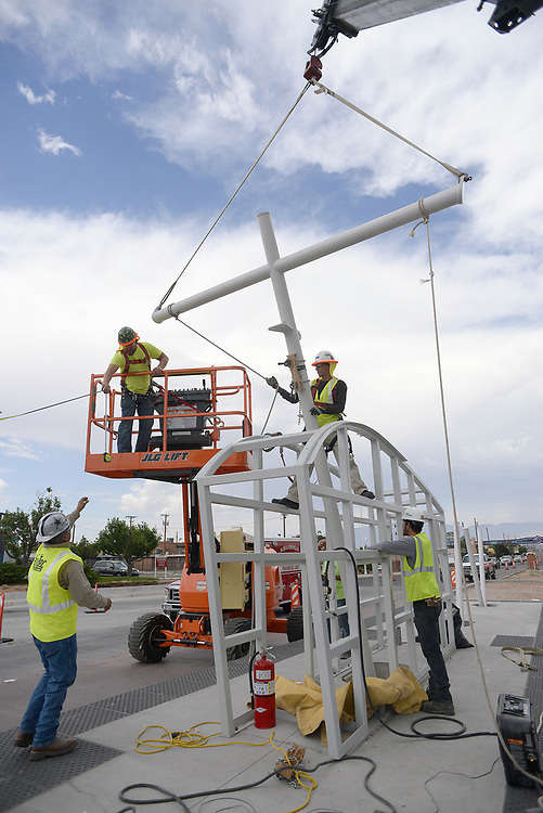 apl070517f/ASECTION/pierre-louis/JOURNAL 070517<br /> Fabritec  workers install  the ART Station shade structure at Central and Coors . The station is the first of 14 where the structures will be installed  .Photographed on Wednesday July  5,  2017. .Adolphe Pierre-Louis/JOURNAL