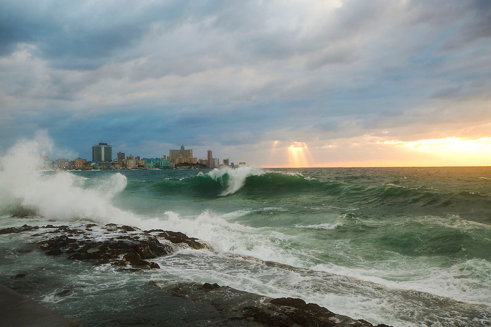 Waves and cloud beams along Malecon in Havana Cuba