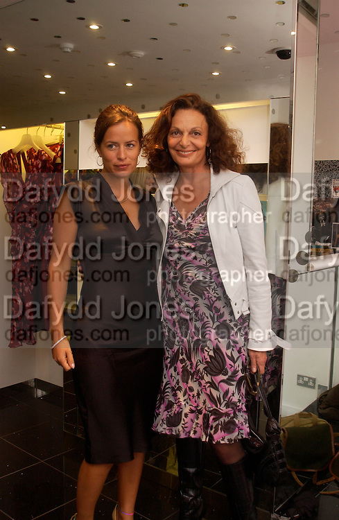Diane von Furstenberg and Jade Jagger, Diane von Furstenberg shop opening, Ledbury Rd. 21 September 2003. © Copyright Photograph by Dafydd Jones 66 Stockwell Park Rd. London SW9 0DA Tel 020 7733 0108 www.dafjones.com
