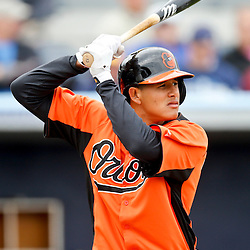 Mar 2, 2013; Port Charlotte, FL, USA; Baltimore Orioles third baseman Manny Machado (13) at bat against the Tampa Bay Rays during the bottom of the third inning of a spring training game at Charlotte Sports Park. Mandatory Credit: Derick E. Hingle-USA TODAY Sports