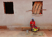 Mother Vincentia Nyirabahutu at work preparing lunch for workmen on building site Mbujanzire village. Near Gasororo village. Bugesera district. Rwanda...© Zute Lightfoot / Water Aid.