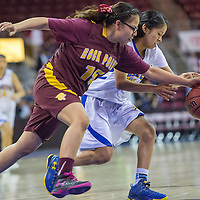 Valley Sanders Pirate Valiyah Yazzie (21) steals the ball away from Rock Point Cougar Keandra Sam (15) Saturday at the Prescott Valley Event Center.