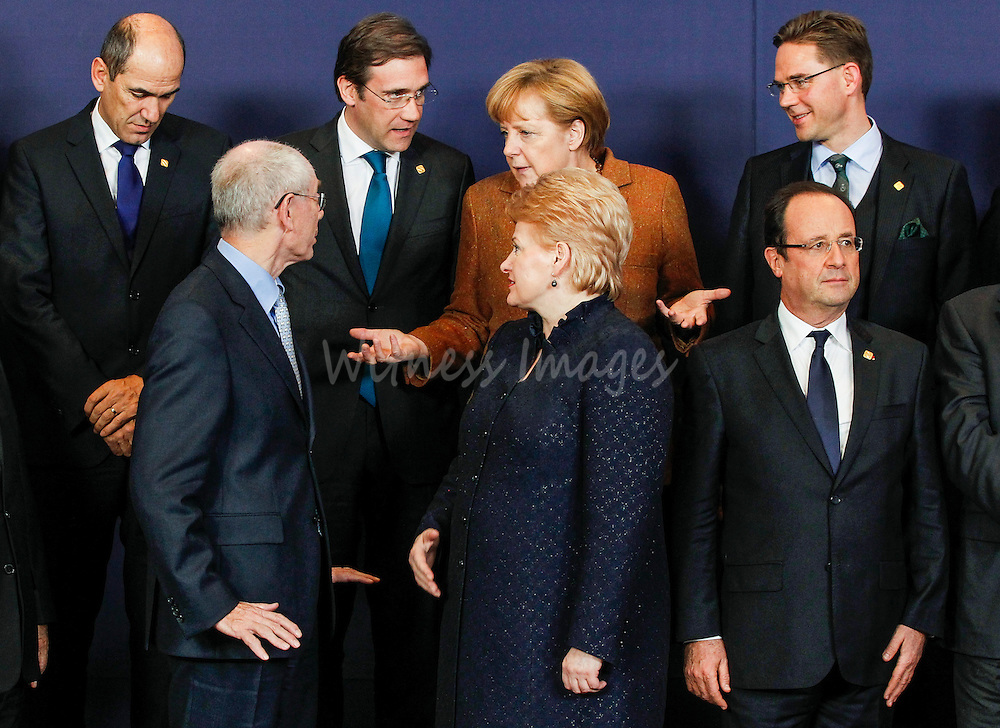 (L-R 1st row) European Council President Herman Van Rompuy, Lithuanian President Dalia Grybauskaite, French President Francois Hollande, (2nd row) Slovenian Prime Minister Janez Jansa, Portuguese Prime Minister Pedro Passos Coelho, German Chancellor Angela Merkel and Finnish Prime Minister Jyrki Katainen pose for a family photo during the European Council Summit at the European Union (EU) headquarters in Brussels, Belgium, 22 November 2012. The budget summit in Brussels is taking place against a backdrop of growing tensions between EU member states over the Brussels-based bloc's budget plans, which cover the 2014-2020 period. The 2014-20 budget - technically known as the multi-annual financial framework or MFF - will set maximum spending limits, as well as define where the money should go and where it should come from.