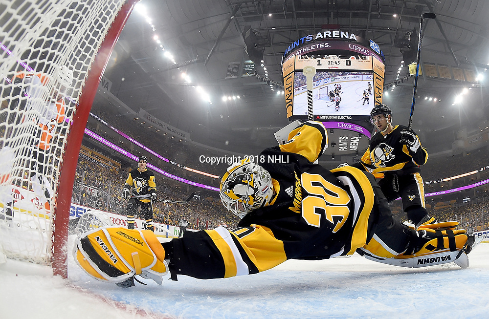 PITTSBURGH, PA - APRIL 11:  Matt Murray #30 of the Pittsburgh Penguins makes a diving save against Scott Laughton #21 of the Philadelphia Flyers in Game One of the Eastern Conference First Round during the 2018 NHL Stanley Cup Playoffs at PPG Paints Arena on April 11, 2018 in Pittsburgh, Pennsylvania.  (Photo by Joe Sargent/NHLI via Getty Images) *** Local Caption ***