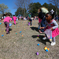 Thomas Wells | BUY at PHOTOS.DJOURNAL.COM<br /> Children hurry to pick up as many eggs as they can before they are all gone.