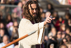 Trafalgar Square, London, March 25th 2016. Thousands of Londoners an tourists in Trafalgar Square are treated to The Passion of Jesus, a re-enactment of the events leading up to the crucifixion and resurrection of Jesus Christ. PICTURED: Jesus on trial. <br /> ©Paul Davey<br /> FOR LICENCING CONTACT: Paul Davey +44 (0) 7966 016 296 paul@pauldaveycreative.co.uk
