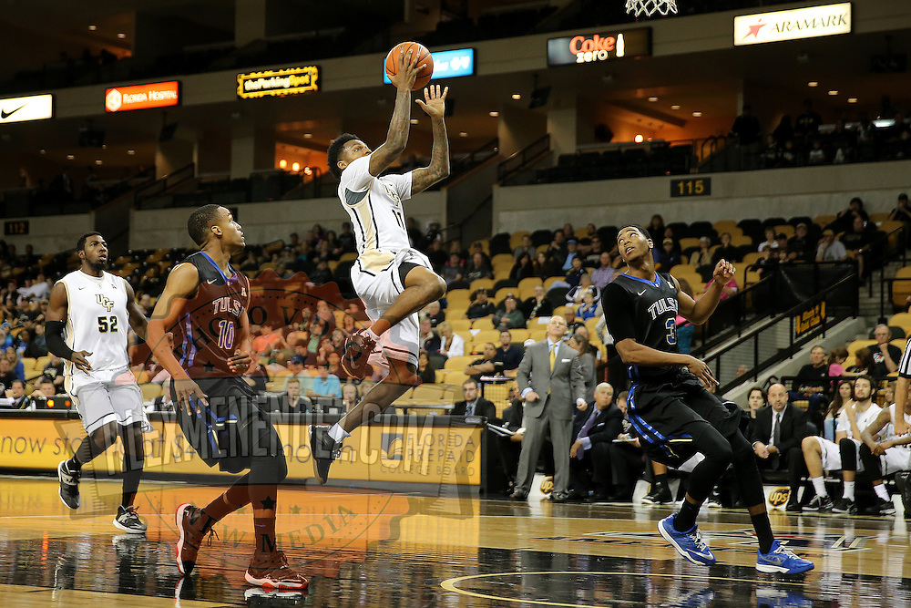 ORLANDO, FL - DECEMBER 31:  Brandon Goodwin #11 of the UCF Knights drives to the net during an NCAA basketball game against the Tulsa Golden Hurricane at the CFE Arena on December 31, 2014 in Orlando, Florida. (Photo by Alex Menendez/Getty Images) *** Local Caption *** Brandon Goodwin