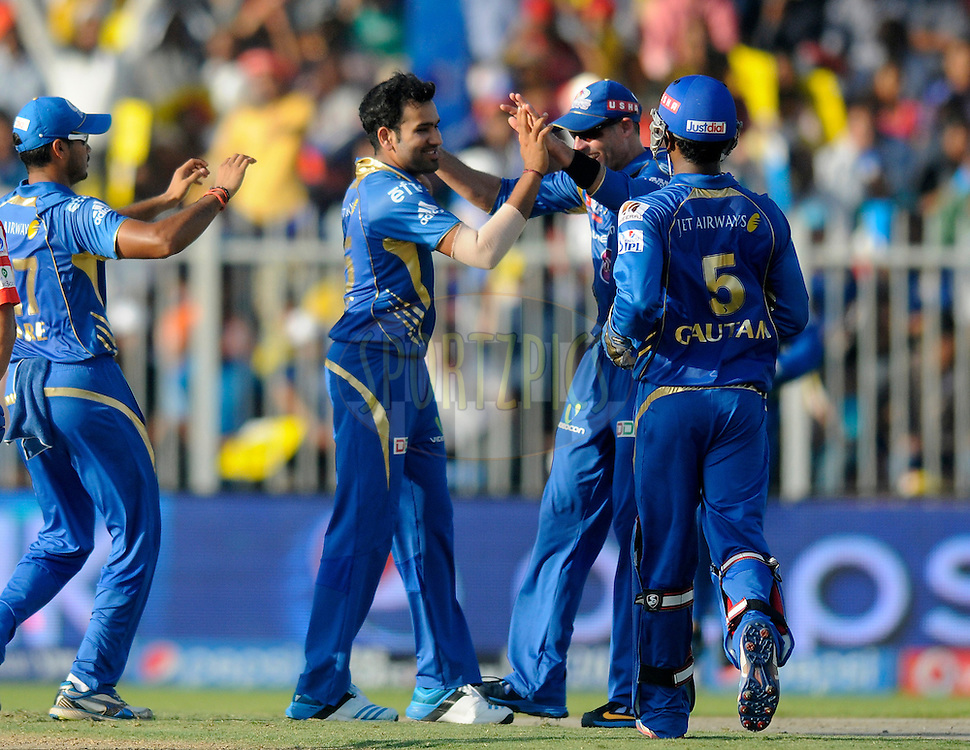 Rohit Sharma captain of of the Mumbai Indians celebrates the wicket of Murali Vijay of the Delhi Daredevils during match 16 of the Pepsi Indian Premier League 2014 between the Delhi Daredevils and the Mumbai Indians held at the Sharjah Cricket Stadium, Sharjah, United Arab Emirates on the 27th April 2014<br /> <br /> Photo by Pal Pillai / IPL / SPORTZPICS