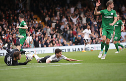Fulham's Rui Fonte (centre) is fouled to earn a penalty for his side