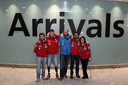 Team Glenfiddich (red coats) and Ed Parker (centre), co-founder of Walking with the Wounded, return home.<br /> The Walking with the Wounded South Pole Allied Challenge 2013 teams return to Heathrow Airport after successfully reaching the South Pole.<br />  Monday, 23rd December 2013. Picture by Ben Stevens / i-Images