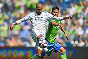 Teal Bunbury #10 of New England Revolution moves the ball against Kim Kee-Hee #20 of Seattle Sounders during a MLS soccer match on Saturday, Aug. 10, 2019, in Seattle. The teams played tp a 3-3 tie. (Alika Jenner/Image of Sport)