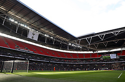 General view of the action in the 37th minute with an empty upper tier in the ground during the Premier League match at Wembley Stadium, London.