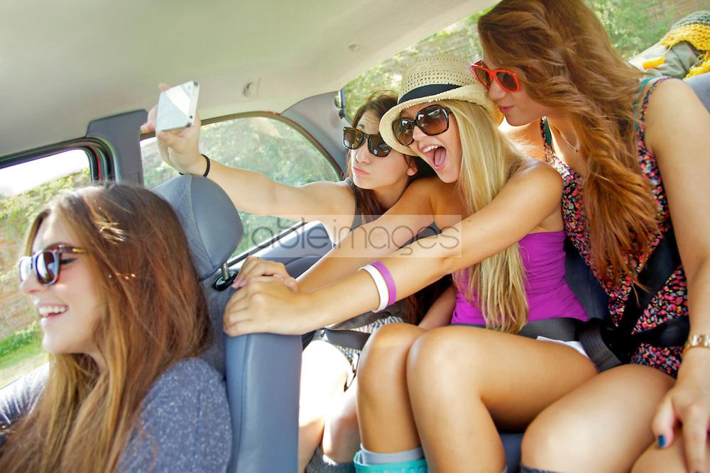 Teenage Girls Taking Self Portrait Photo Inside Car