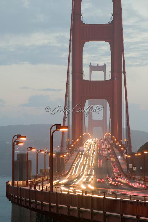 Golden Gate Bridge traffic at dusk-San Francisco, CA