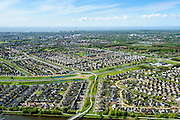 Nederland, Flevoland, Lelystad, 07-05-2015; Lelystad als stedelijk conglomoraat, urbanisatie in de polder met de wijken Waterwijk en De Landerijen in de voorgrond.<br /> New town Lelystad with its recently build neighborhoods.<br /> luchtfoto (toeslag op standard tarieven);<br /> aerial photo (additional fee required);<br /> copyright foto/photo Siebe Swart