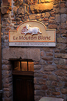 Souvenir shops, hotels and restaurants line the narrow cobblestone street through Mont San Michel, off the coast of Normandy, France. Le Mouton Blanc is a small hotel in the town.