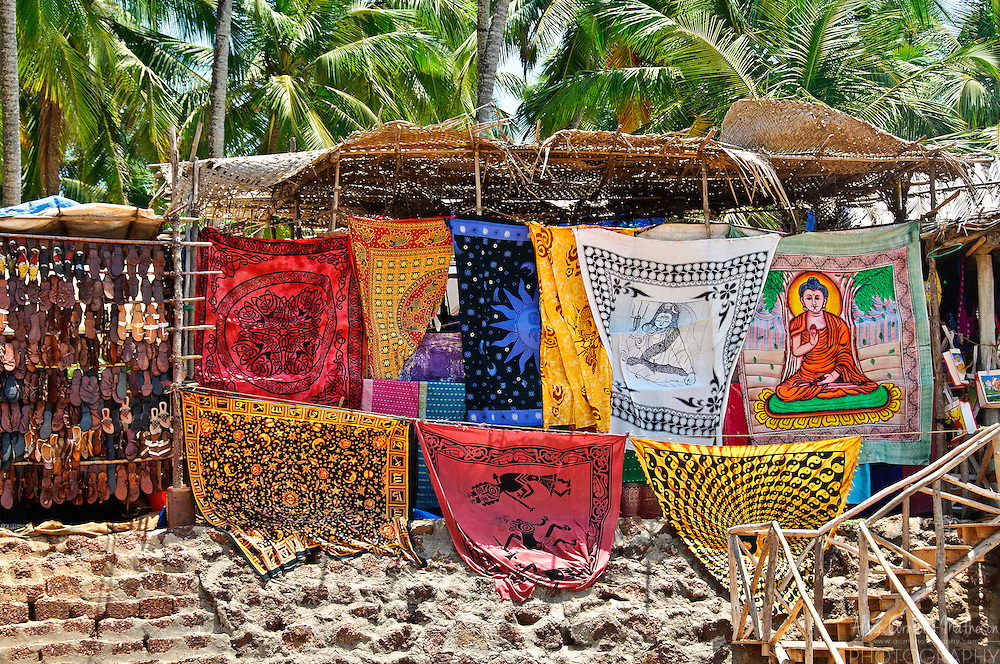 Textiles and sandals are sold to tourists at the Anjuna Beach market in Goa, India.