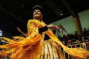 Sarita, alias &quot;The Romantic&quot;, dances to the rhythm of music and moves her pollera &ndash;a baggy skirt- to enter into the wrestling ring. The Cholitas wear the traditional costumes of Aymara people during wrestling shows in El Alto, Bolivia, February 26, 2012.<br /> SPANISH: Sarita alias La Romantica baila al ritmo de la m&uacute;sica moviendo su pollera en el momento de la entrada al cuadril&aacute;tero de lucha libre. Las Cholitas usan el vestido tradicional de los Aymara para luchar en el cuadril&aacute;tero, en El Alto, Bolivia, el 26 de Febrero de 2012.