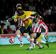 Southampton - Tuesday, September 30th, 2008: Omar Koroma of Norwich City tries to get between 2 defenders during the Coca Cola Championship match at Southampton. (Pic by Daniel Hambury/Focus Images)