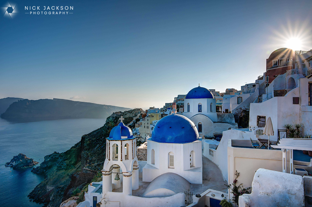 Famed for its beautiful blue domes, Santorini just before sunset is paradise