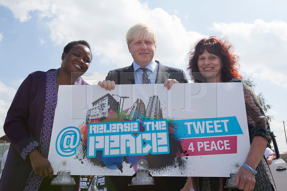 © licensed to London News Pictures. London, UK 14/06/2012. Boris Johnson posing with Margaret Mizen and Grace Idowu at Cooper's Lane Primary School today whose teenage son were murdered. Photo credit: Tolga Akmen/LNP