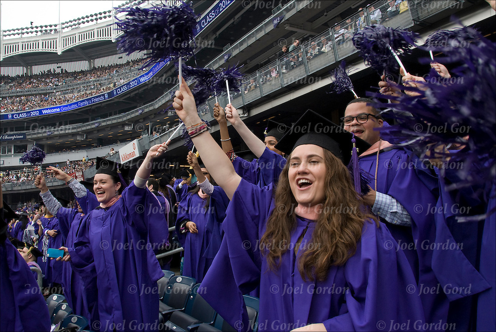Crowd of females and one male at NYU college graduation in caps and gowns.<br />