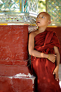 Burma/Myanmar, Mandalay. Young novice staring at one point after he'd seen something interesting.
