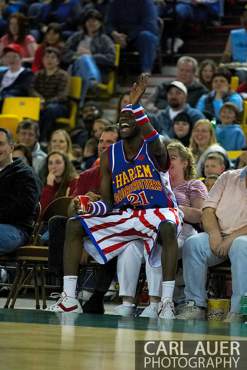 "05 May 2006: Kevin ""Special K"" Daley waves to his team mates while sitting on a fan to watch the Harlem Globetrotters vs the New York Nationals at the Sulivan Arena in Anchorage Alaska during their 80th Anniversary World Tour."